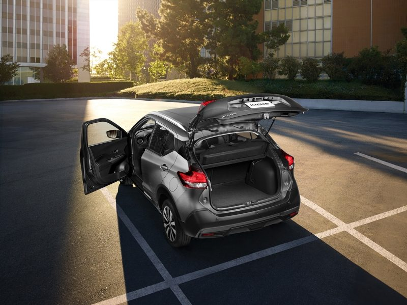 Brown Nissan Kicks exterior with cargo door open