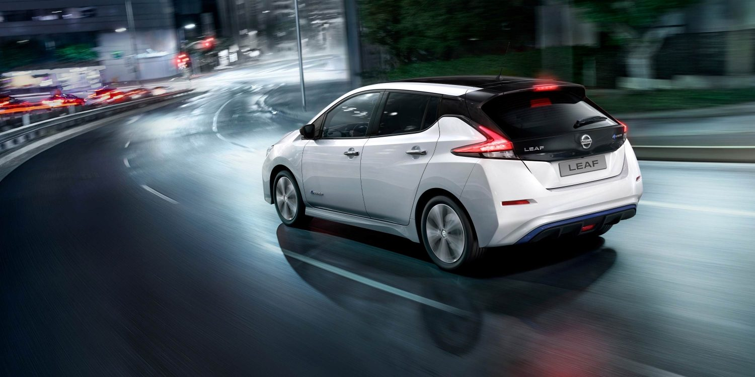 Nissan LEAF driving in the city at night