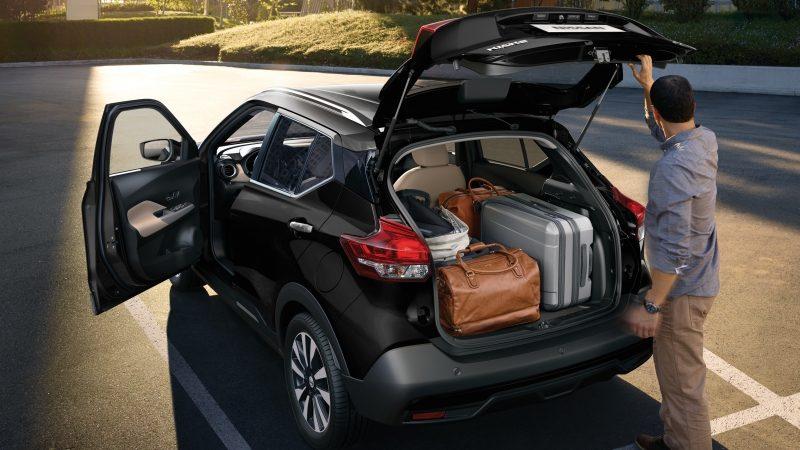 Brown Nissan Kicks exterior with cargo door open