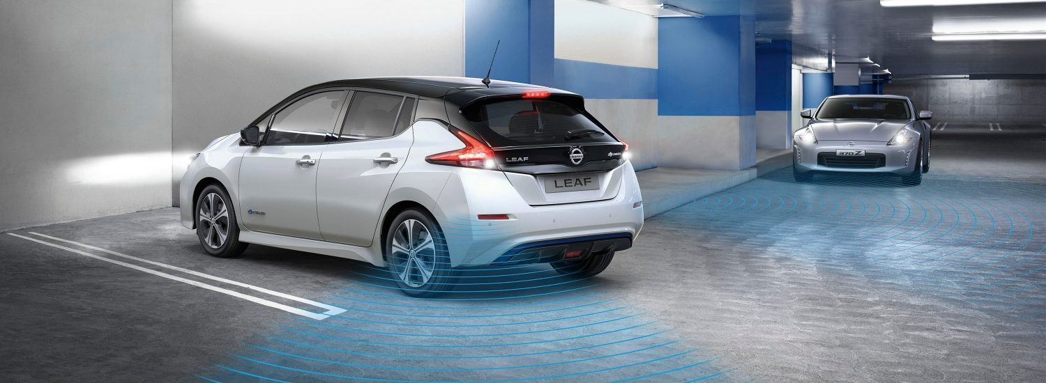 Nissan LEAF in a garage showing Rear Cross Traffic Alert detecting a vehicle coming towards it