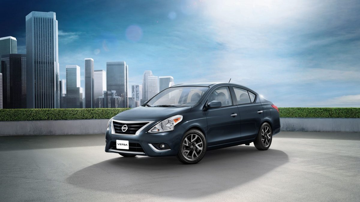 Nissan Versa parked in front of view of city