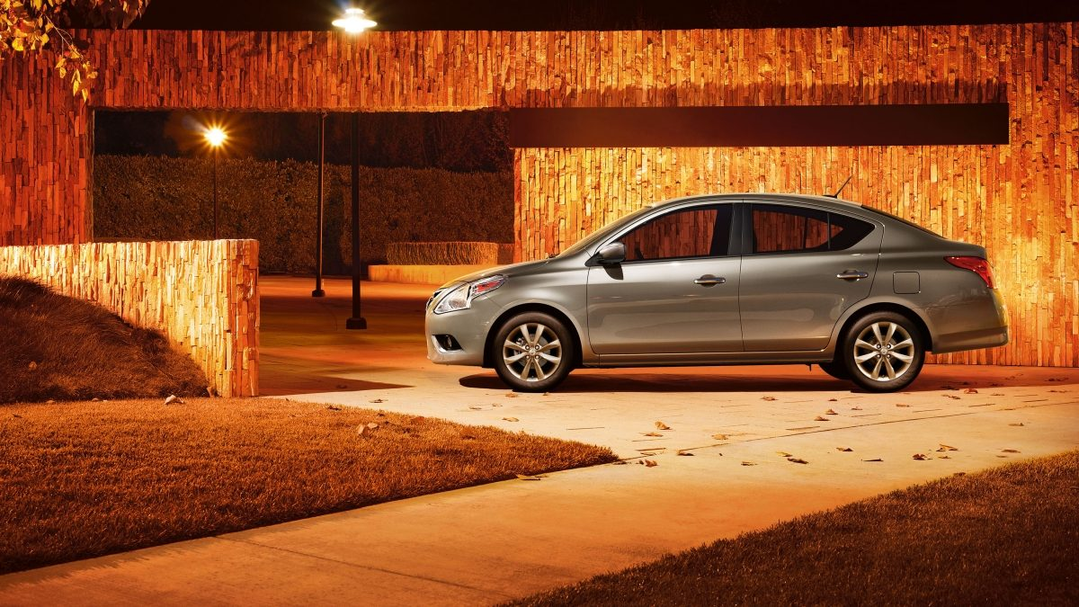 Nissan Versa in park at night