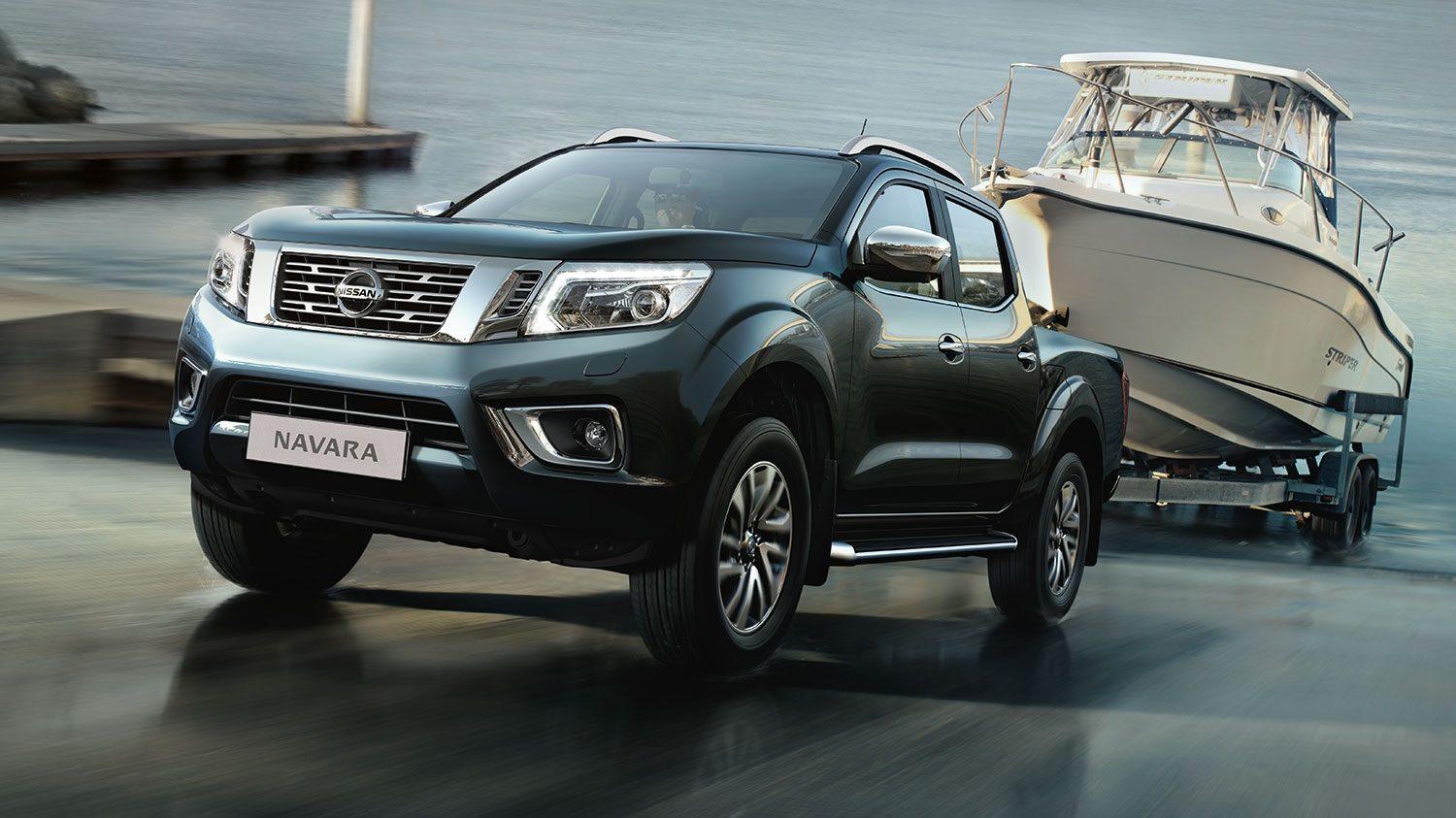 Nissan Navara Cayman Blue - 3/4 front action view towing boat