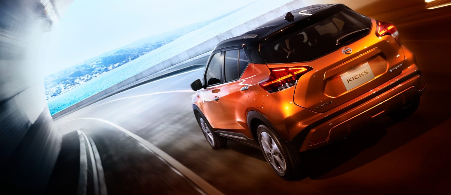 Nissan Kicks EV driving near the sea