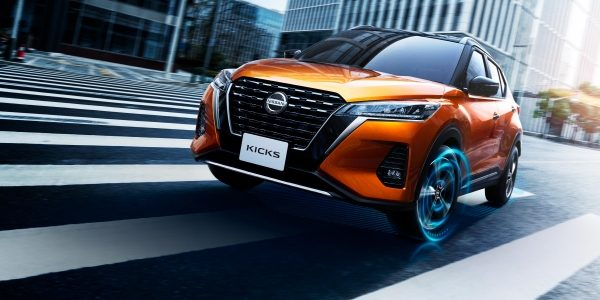 Nissan Kicks EV driving in the city