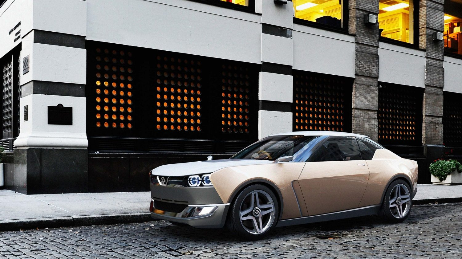 Nissan IDX Freeflow Concept low 3/4 rear parked in city.
