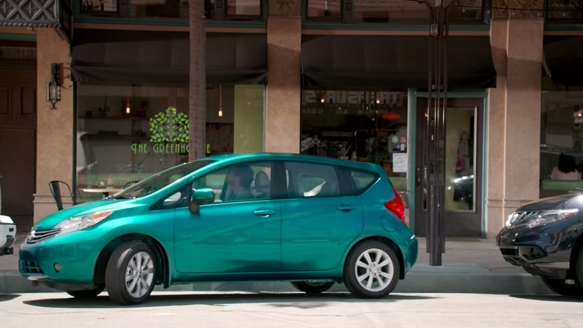 Versa Note parallel parking in city.