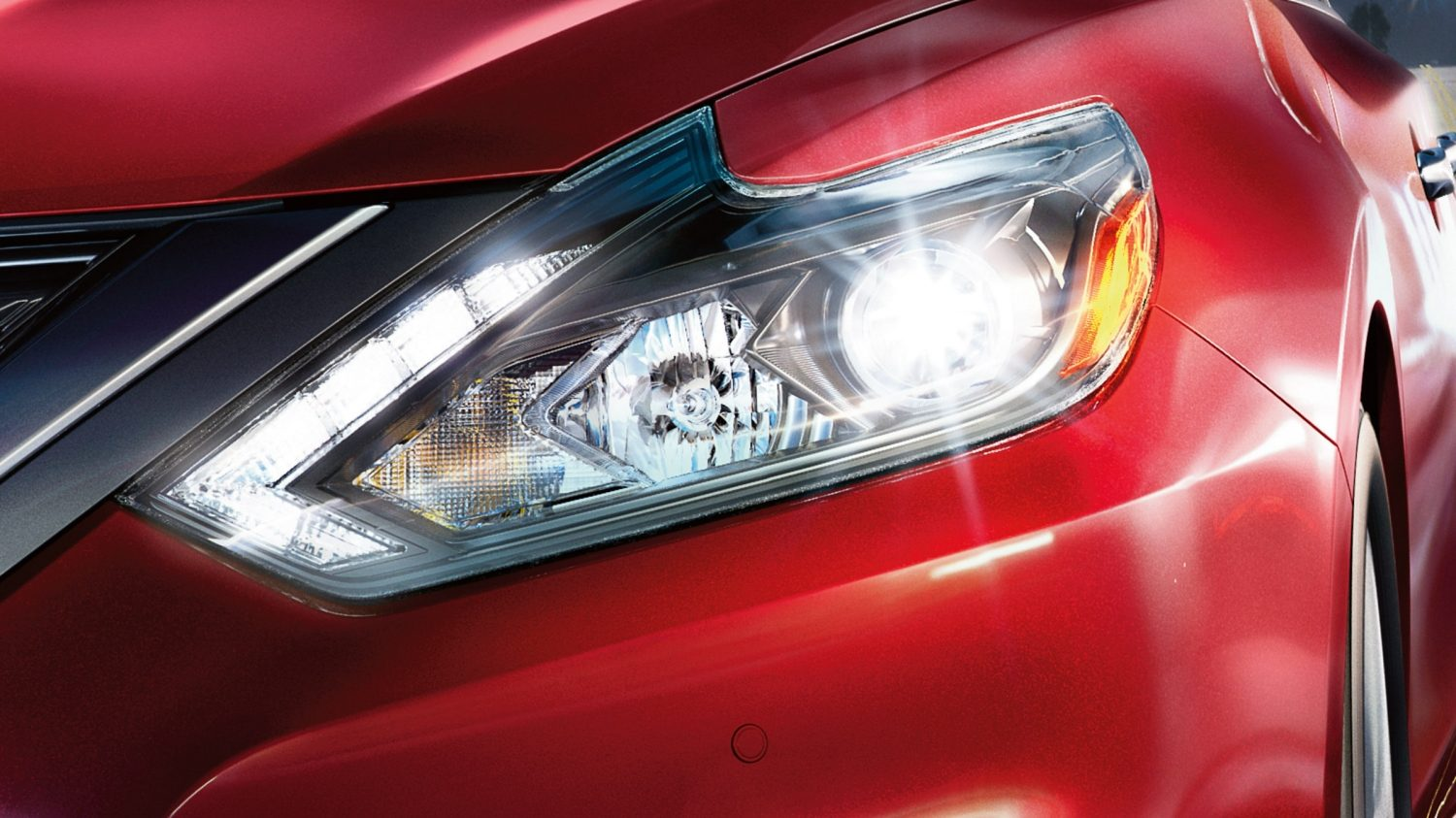 Nissan Altima close up of LED headlights and LED signature line