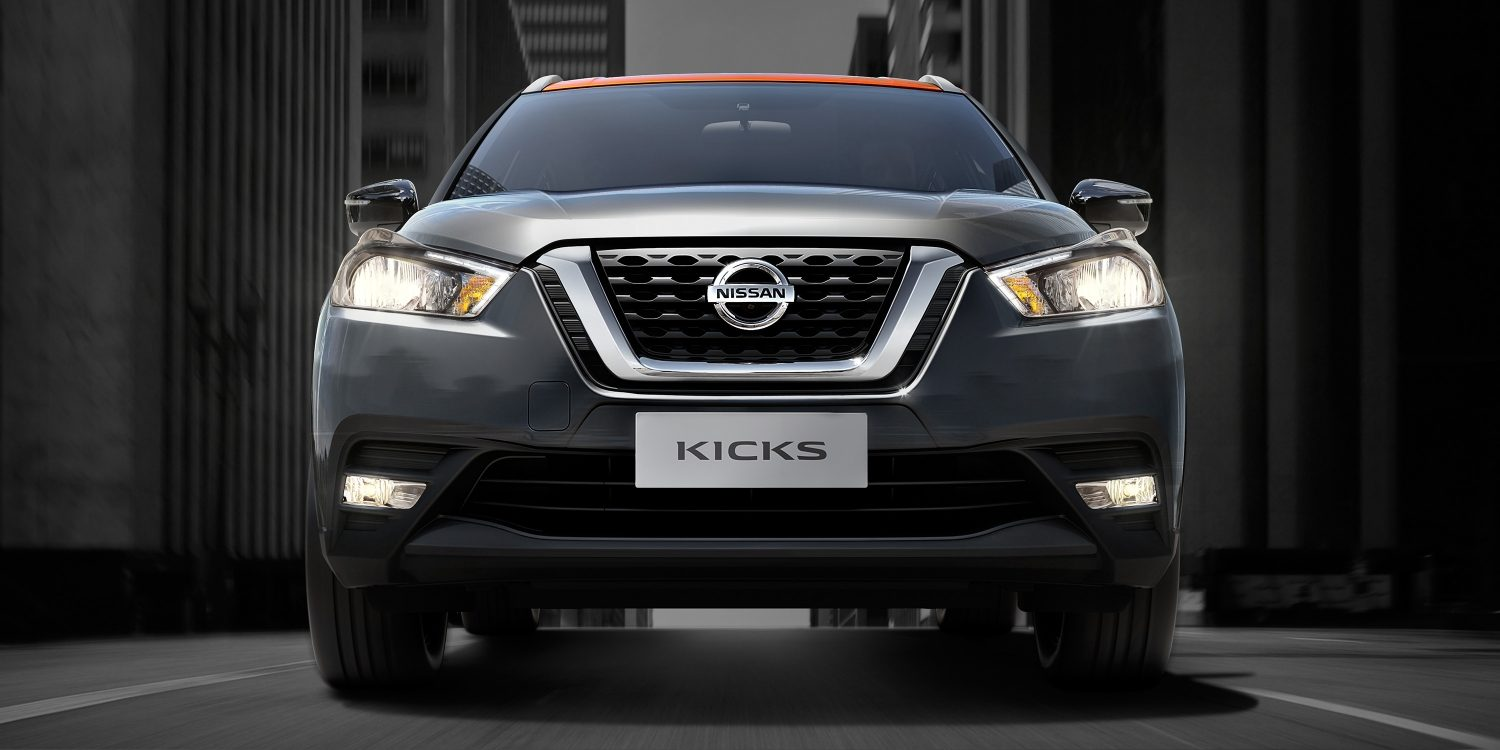 Orange and gray Nissan Kicks front exterior on city street