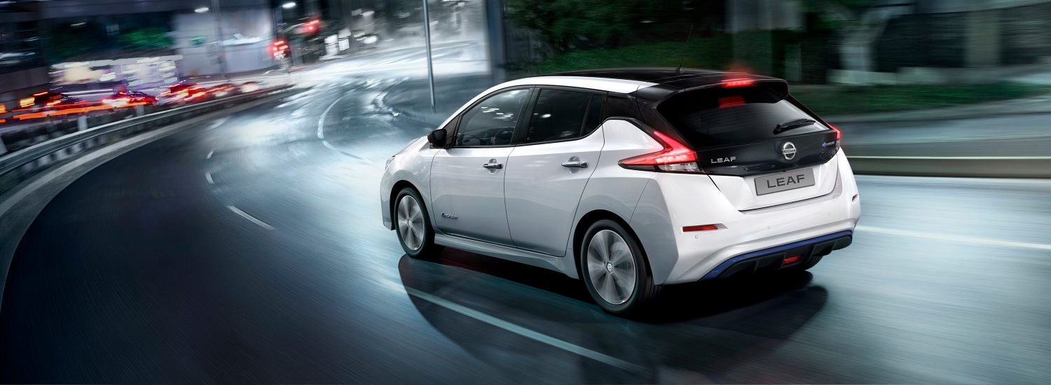 Nissan LEAF driving on a city street at night