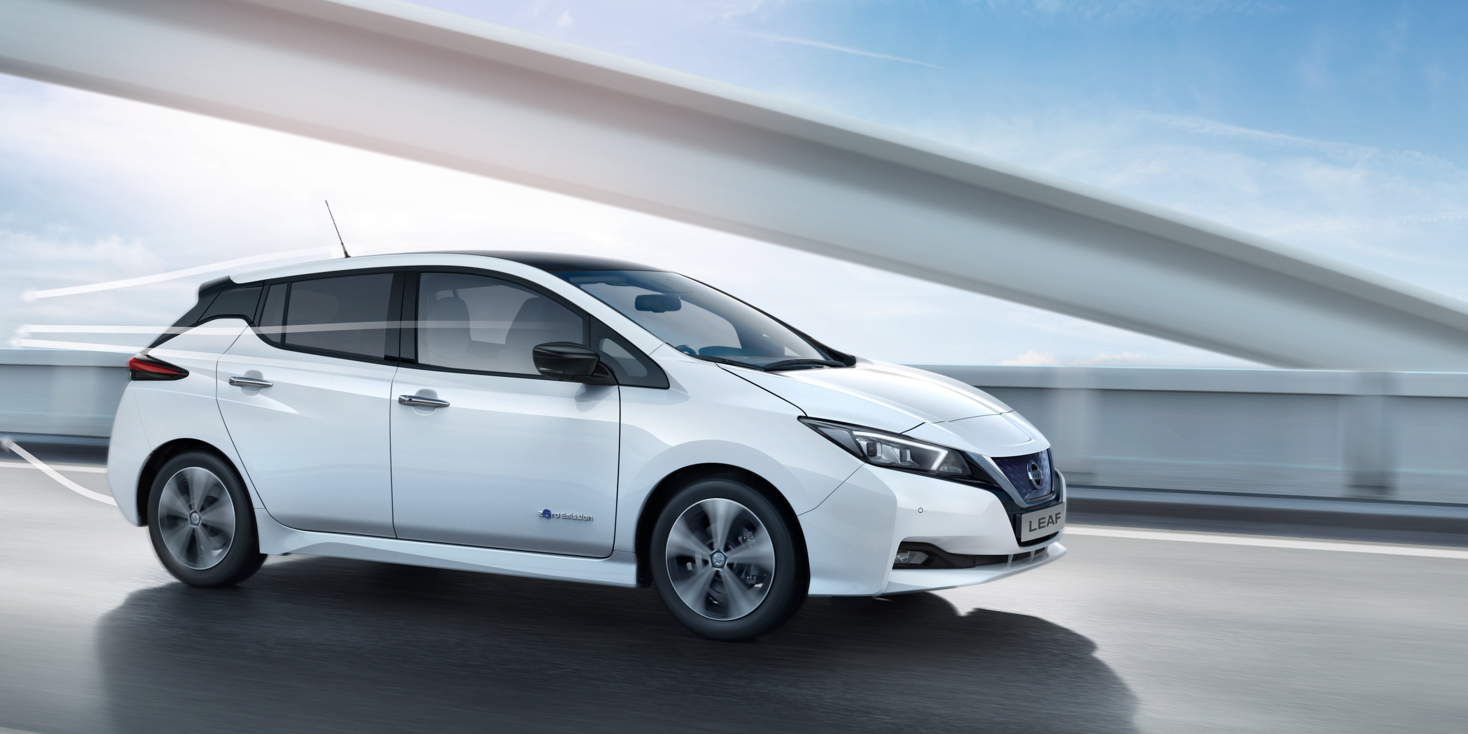 Nissan LEAF driving on a bridge with graphic lines moving over it showing aerodynamics