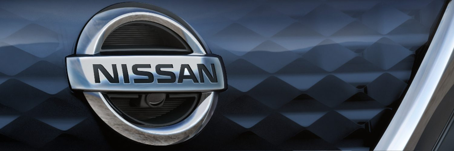 Nissan LEAF close up of Nissan emblem on grille