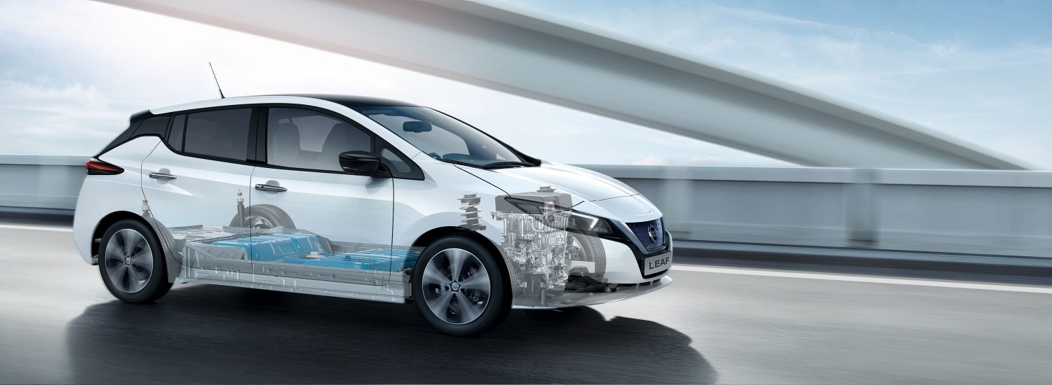 Nissan LEAF driving on a bridge with battery and motor showing