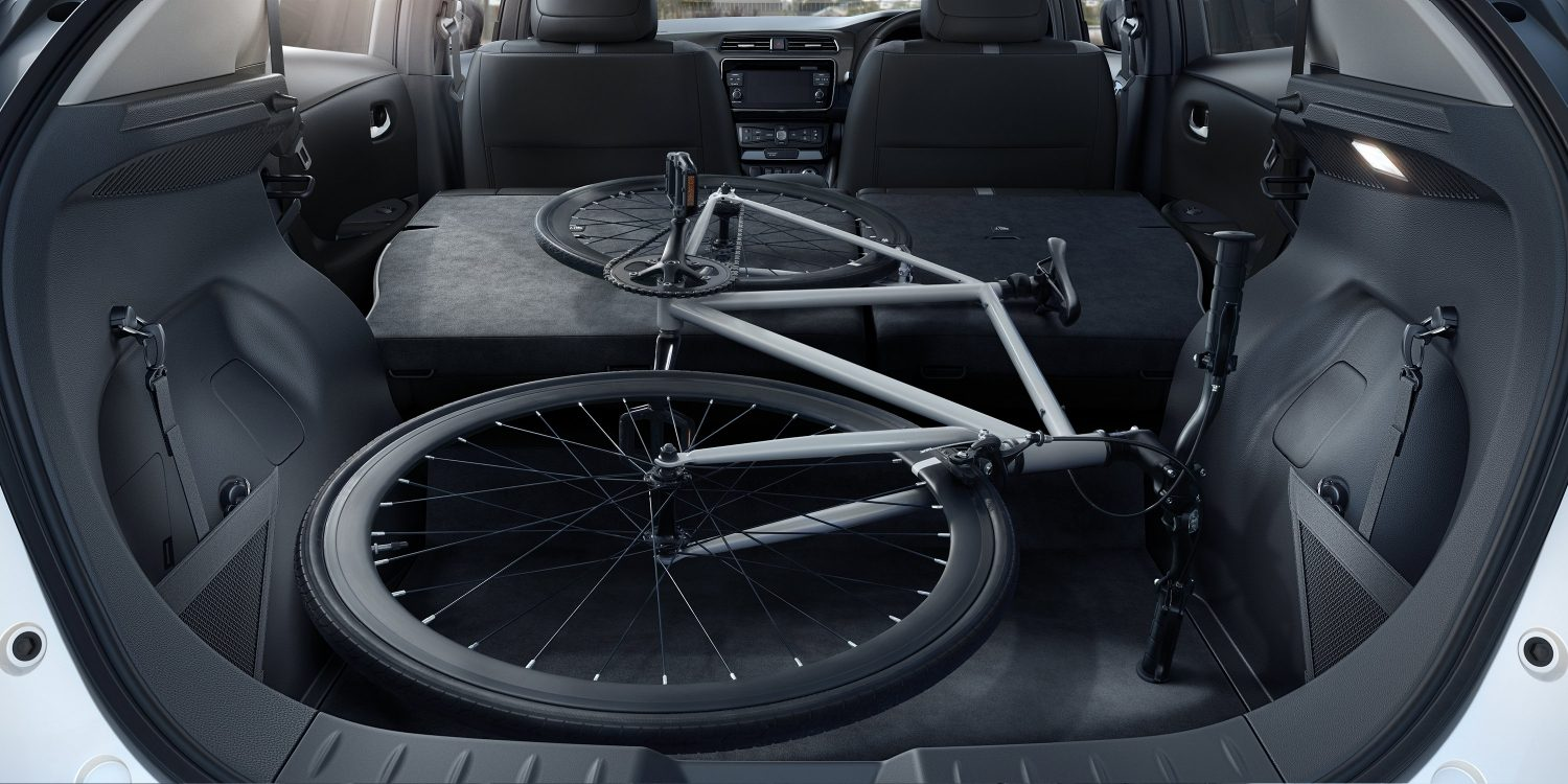 New Nissan LEAF interior showing seats folded down and bike inside