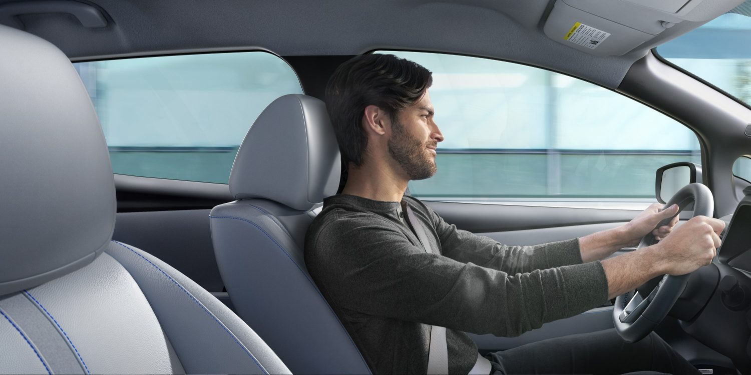 Nissan LEAF interior with man driving