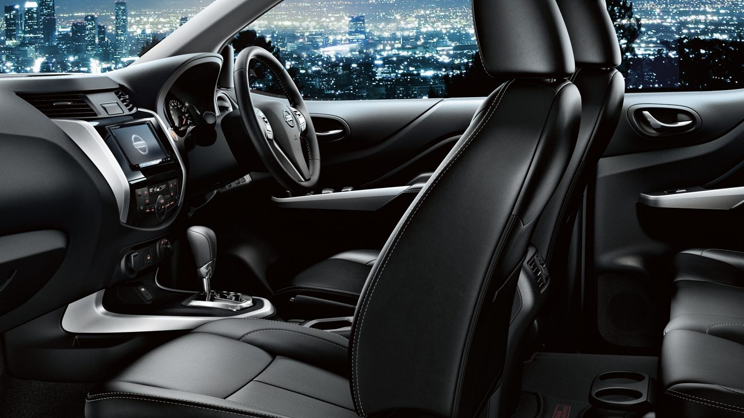 Nissan Navara interior profile in front of cityscape