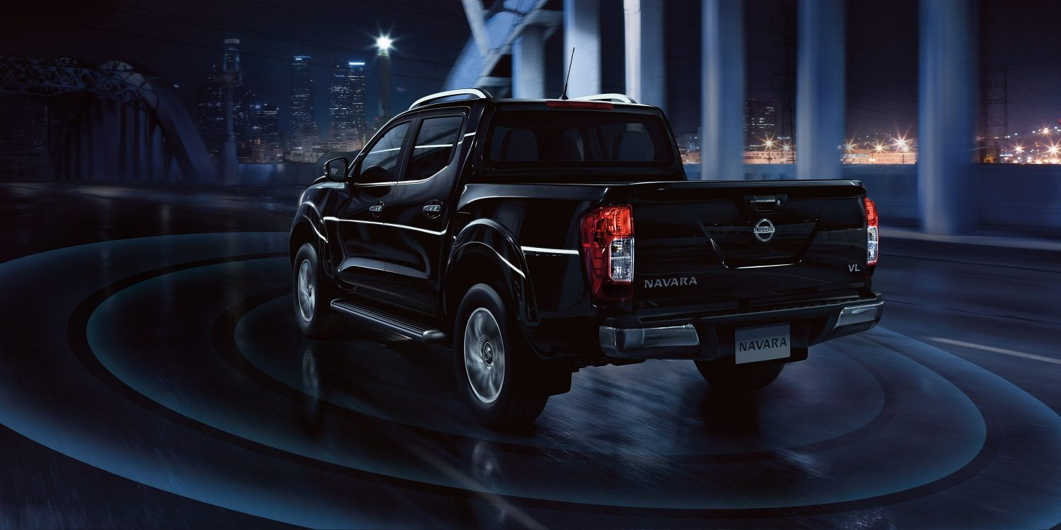 Nissan Navara parked in front of cityscape with safety shield rings illustration