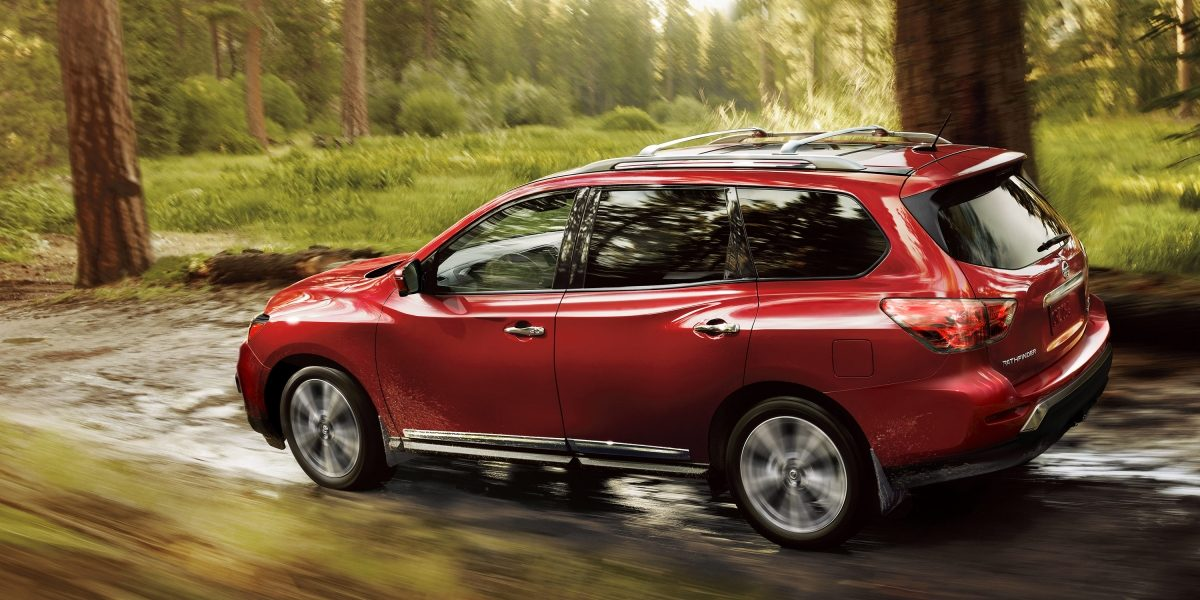 Nissan Pathfinder driving through the woods