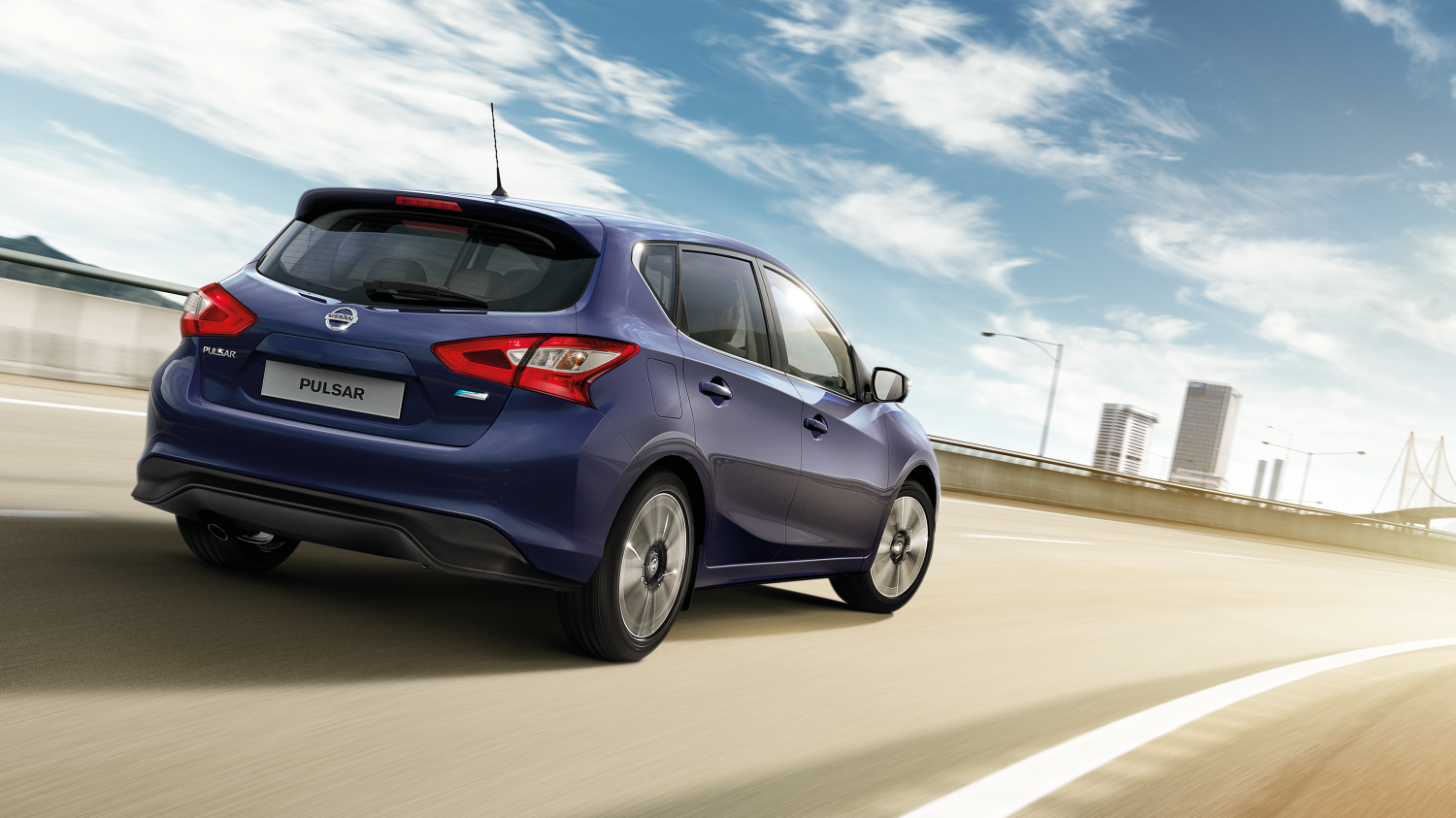 Nissan Pulsar – Hatchback | 3/4 back action shot on road
