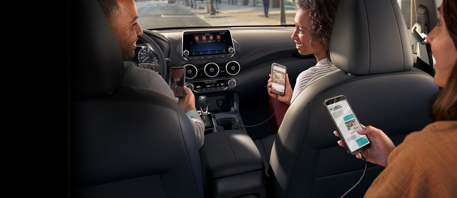 Nissan Sentra interior showing passengers using mobile devices