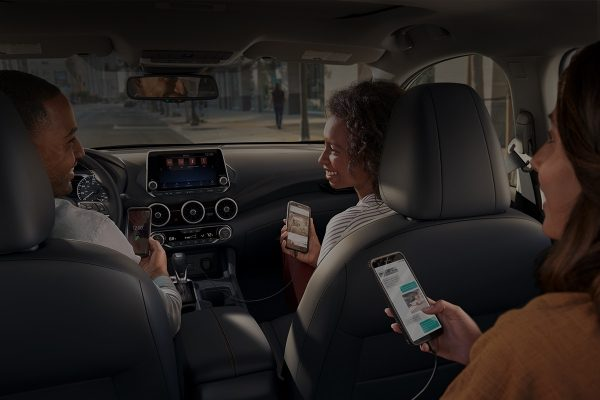Passengers using mobile devices in a 2020 Nissan Sentra