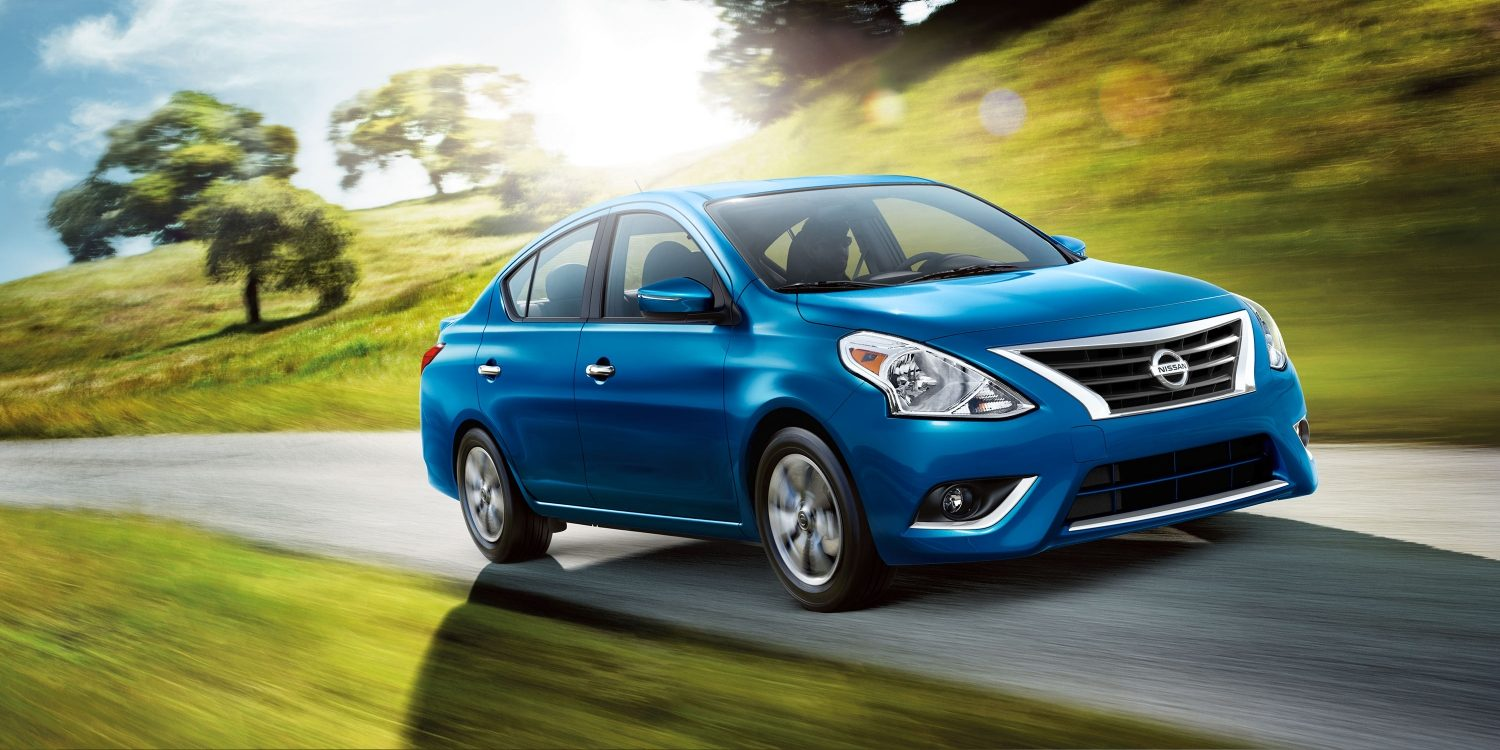 Nissan Versa driving in countryside