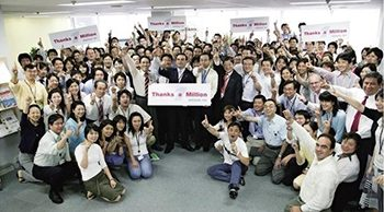 Carlos Ghosn and Nissan Motor employees celebrate addition of 1 million vehicles.