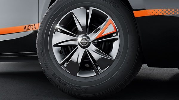 BLACK PAINTED WHEEL COVER WITH ORANGE INSERTS