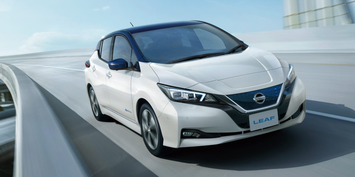 Nissan LEAF shown from behind the wheel driving on the highway