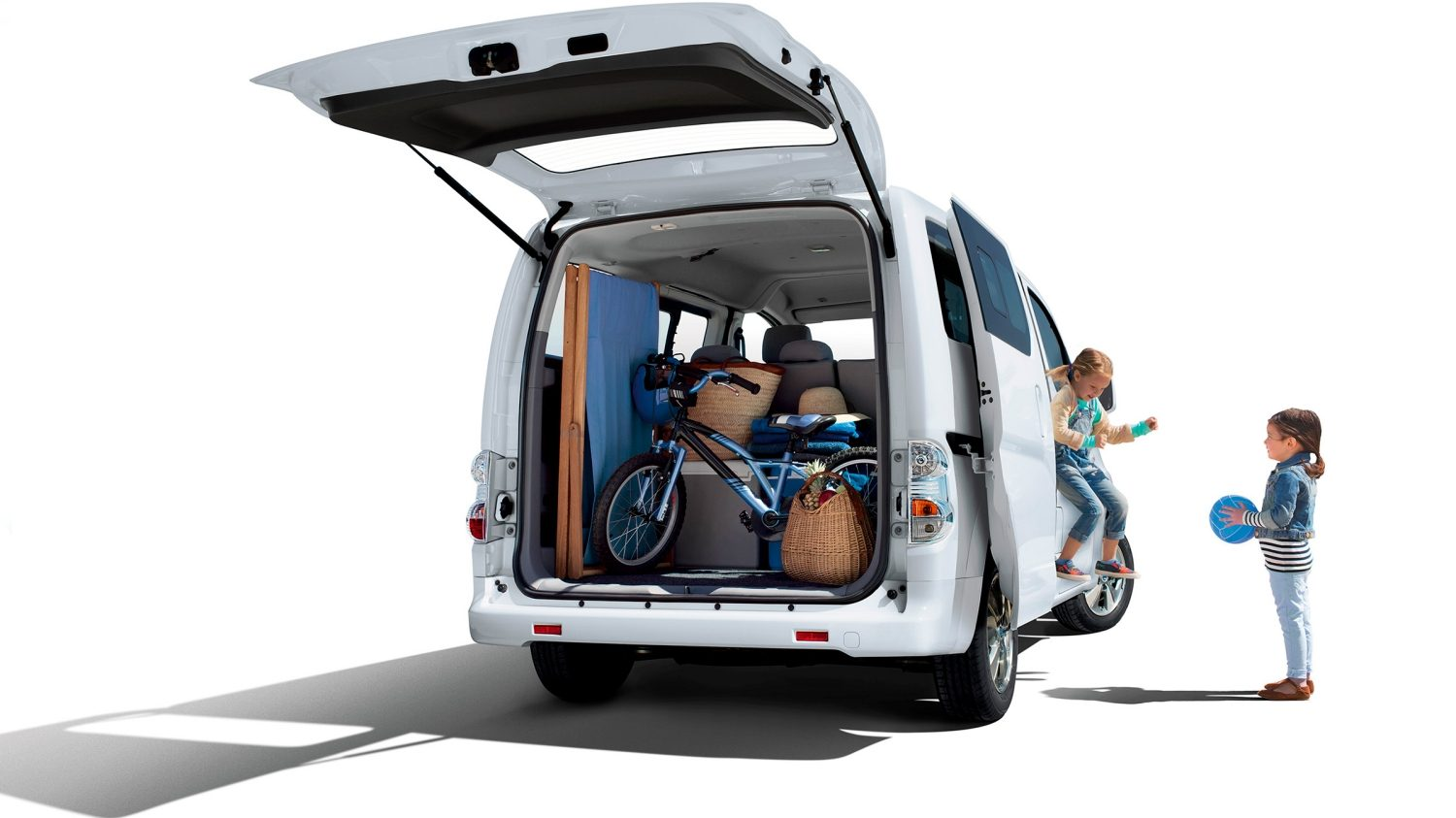 New Nissan e-NV200 COMBI exterior rear view with trunk door open and children