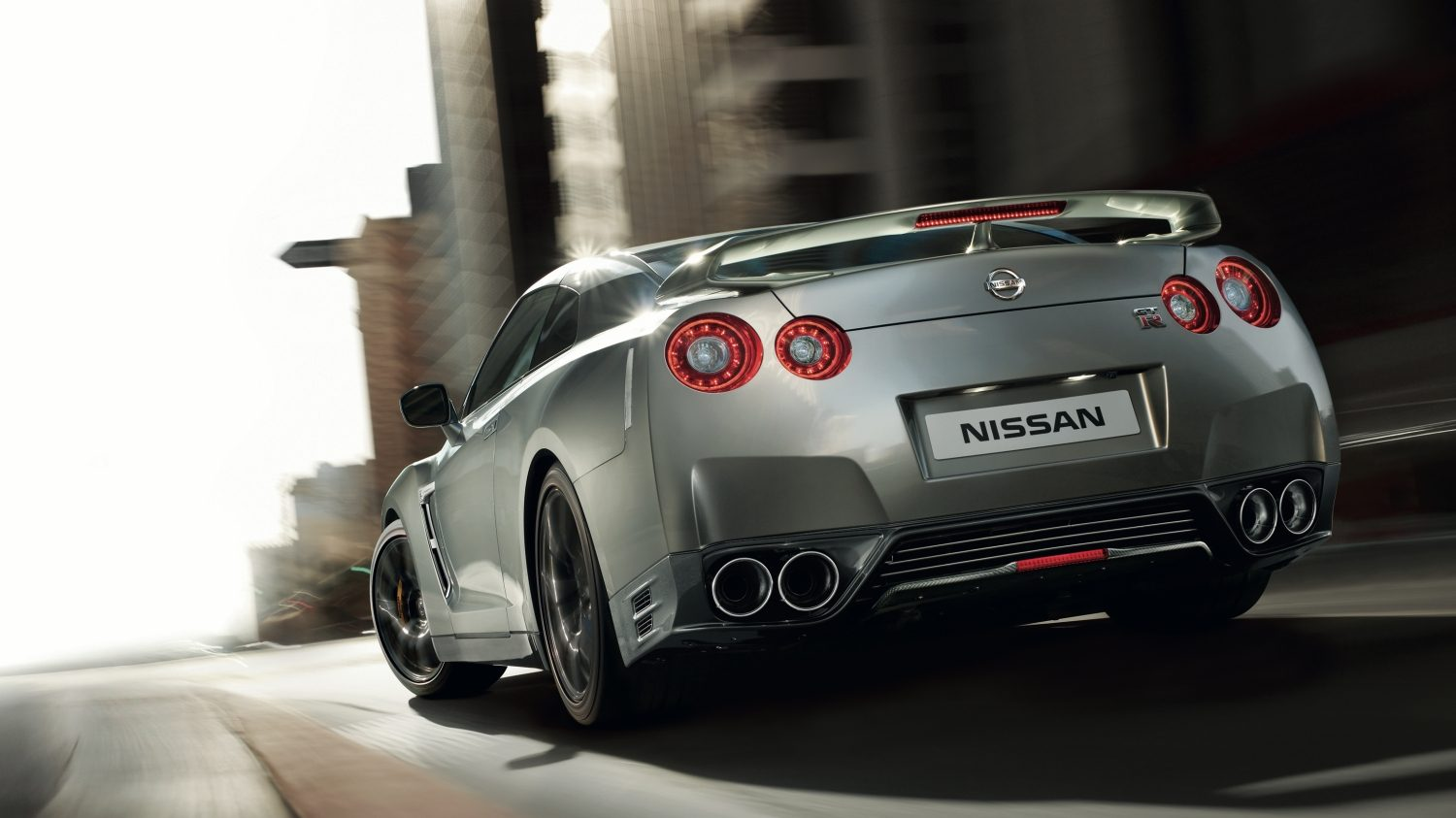 Nissan GT-R grey - Back view of car driving