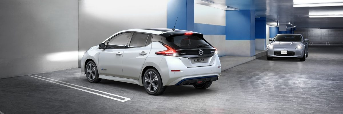 New Nissan LEAF backing out of a parking spot with a car coming towards it