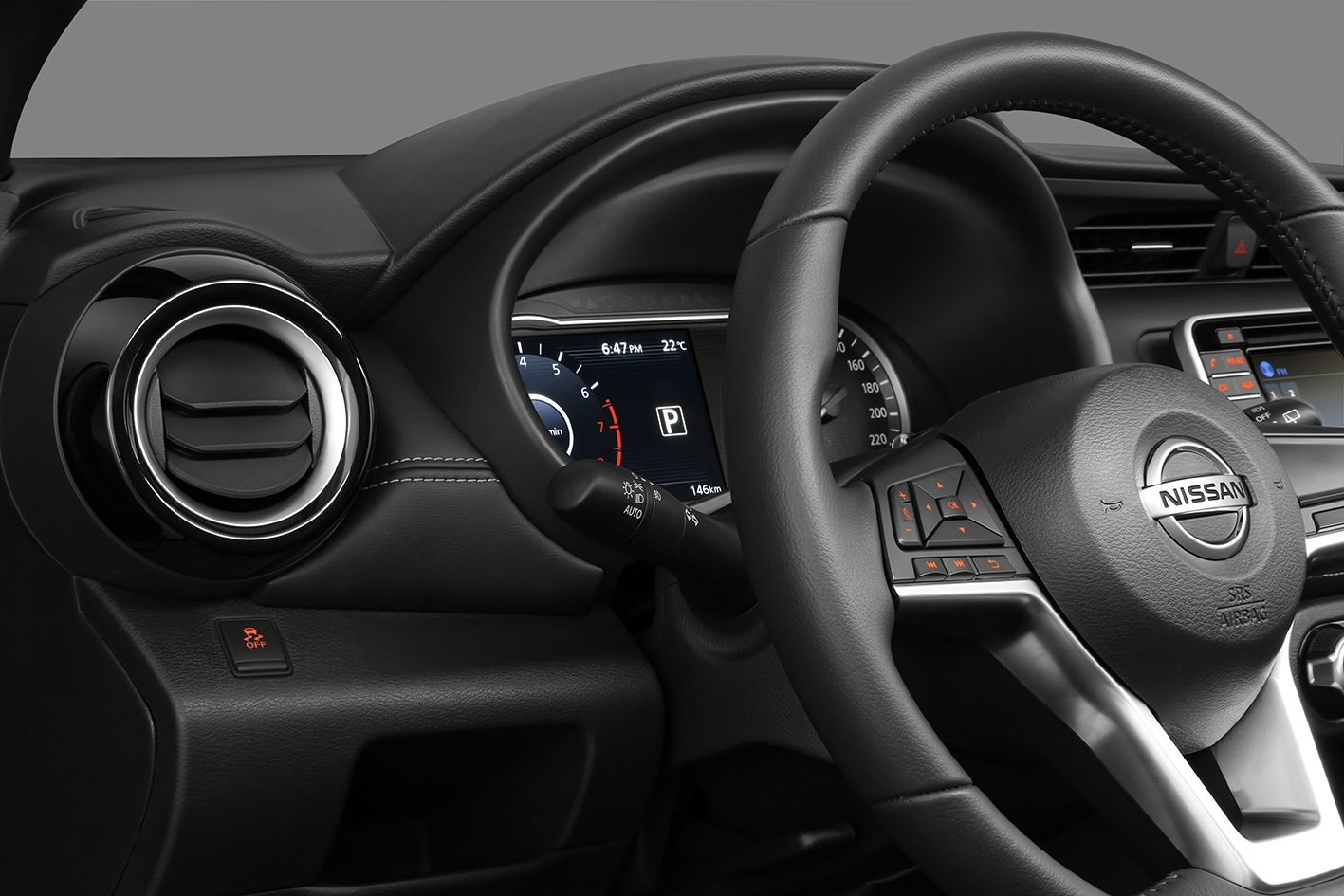 Nissan Kicks air conditioning vent and gauge-cluster detail