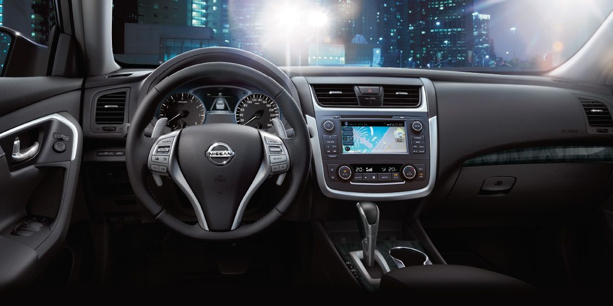 Nissan Altima interior showing steering wheel and dash