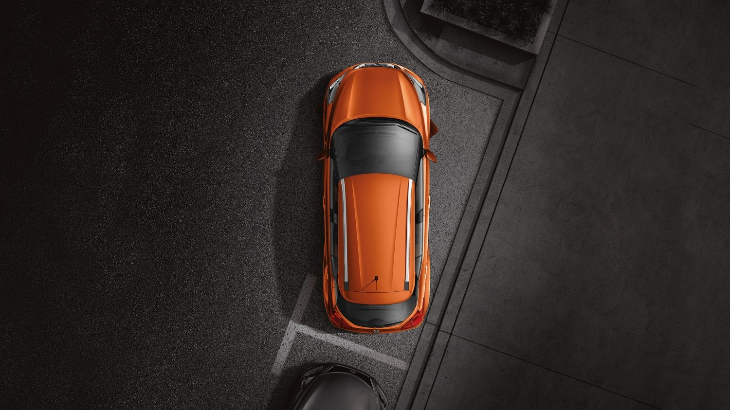 Overhead of orange and gray Nissan Kicks exterior