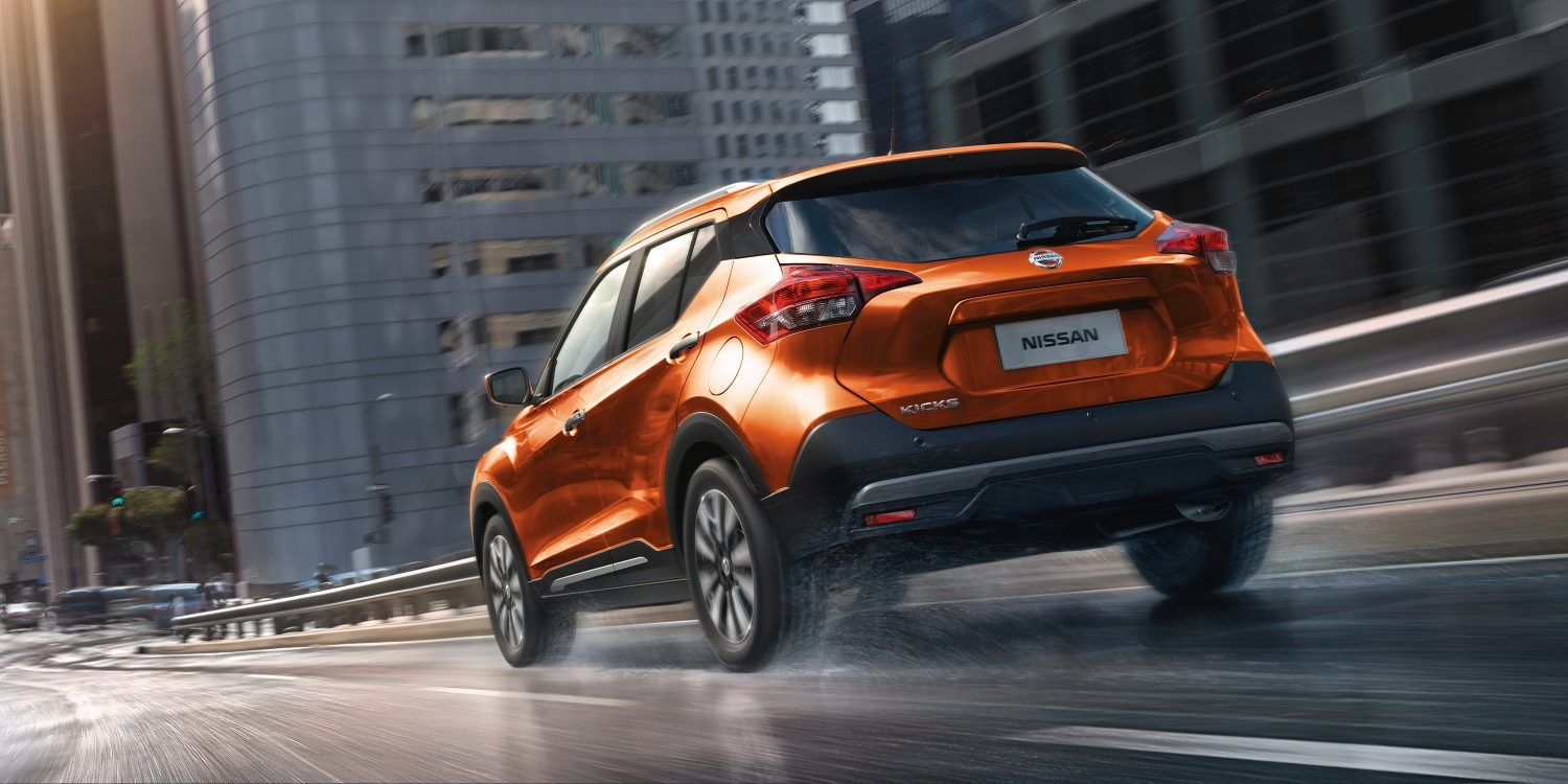 Orange and gray Nissan Kicks exterior on highway ramp