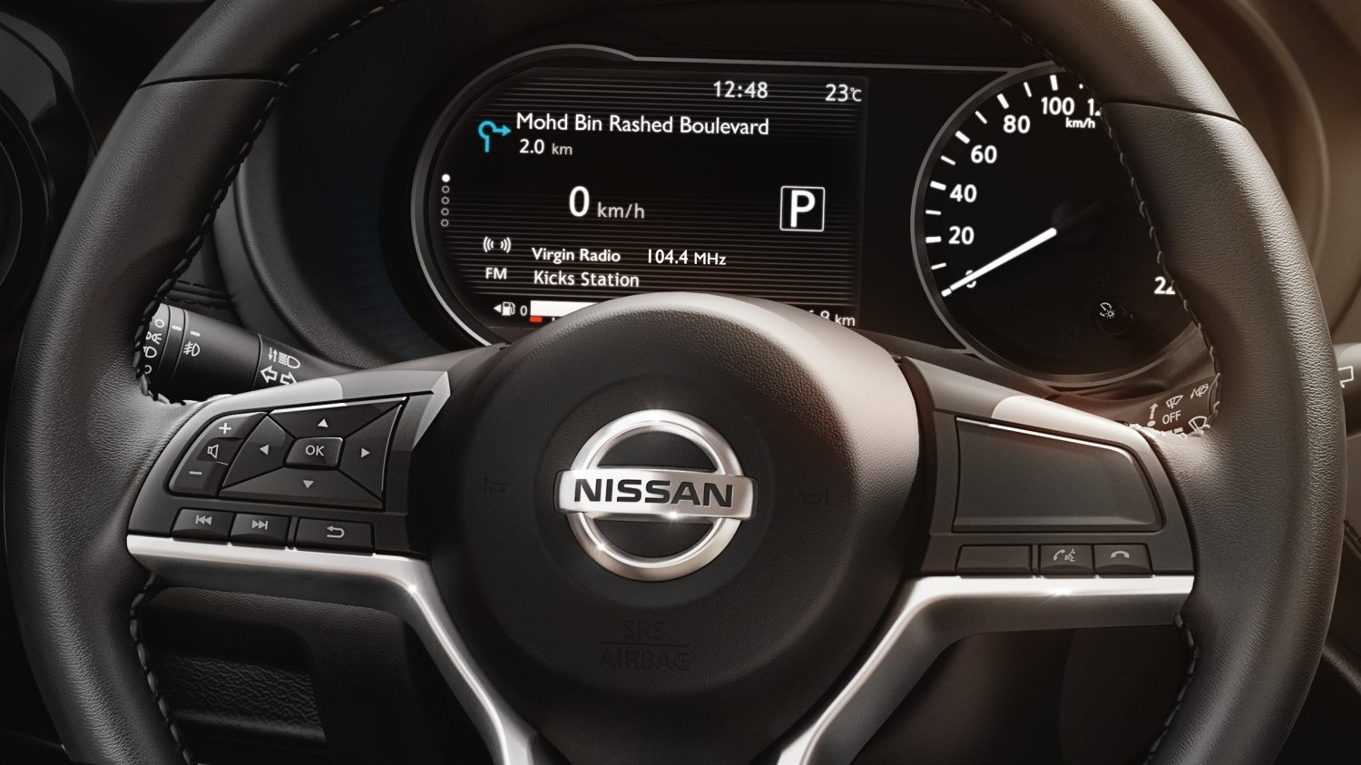 Nissan Kicks steering wheel controls and gauge cluster