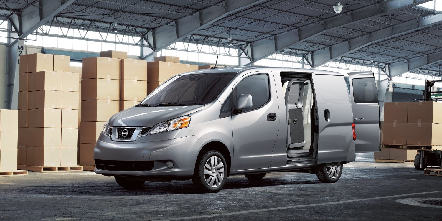 Nissan NV200 compact cargo in a warehouse with doors open