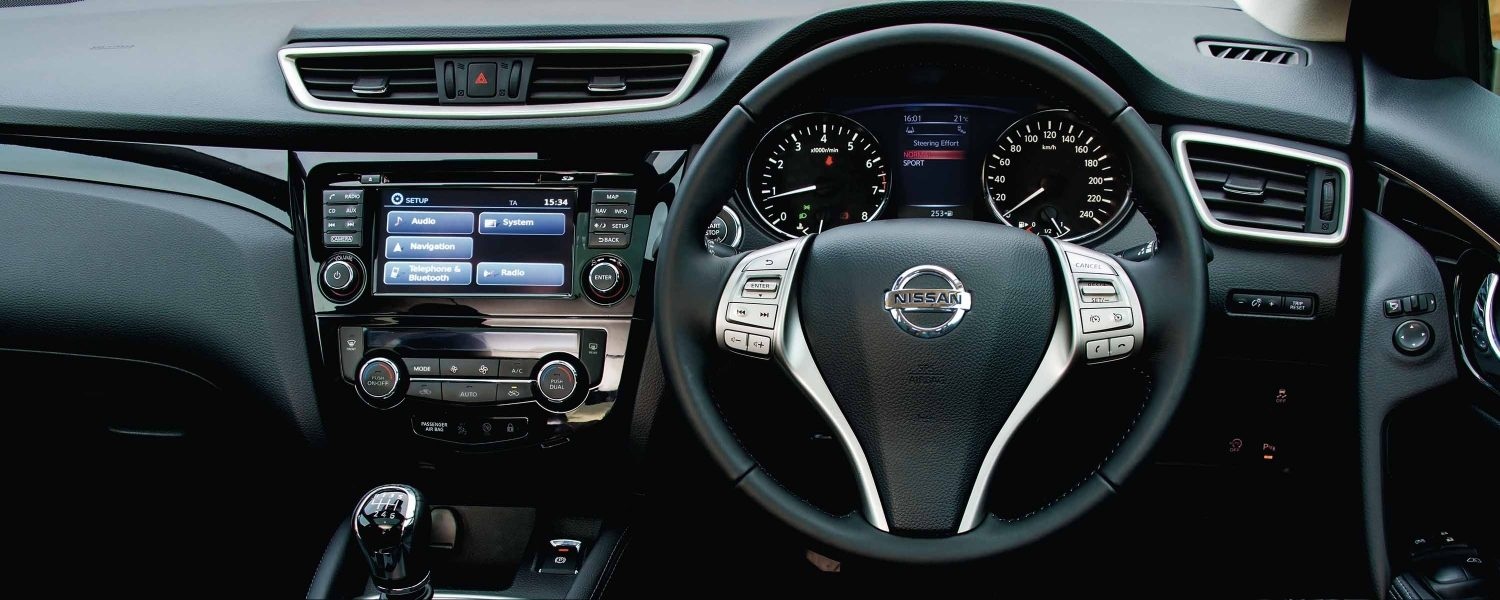 Interior shot of steering wheel and dashboard